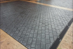 Brick and stone-effect surface