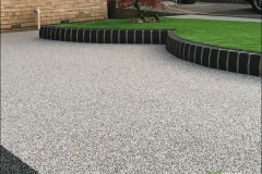 Grey space with border and artificial grass